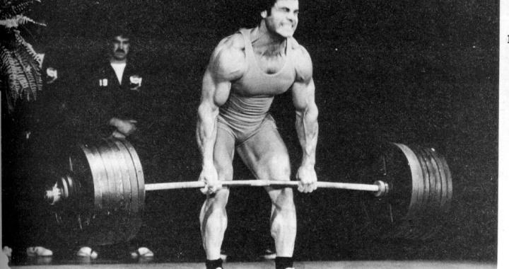 old time strong man bar bending