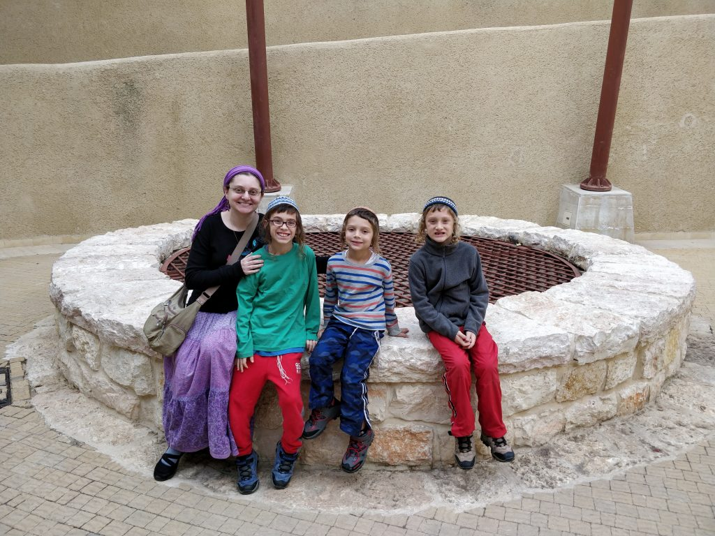family at abraham's well in Beer Sheva, Israel